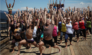 John Friend, center, a famous yoga instructor, leads a session at the Wanderlust festival at Lake Tahoe. (c) Jon Hyde for NY Times.
